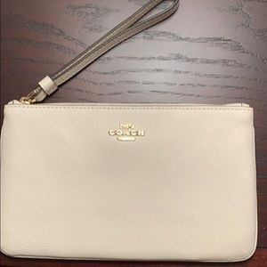 Ivory leather Coach Clutch/wristlet.